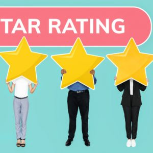 Diverse people showing golden star rating symbol